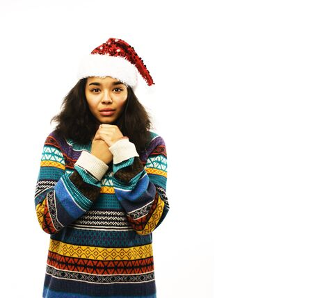 cute young girl in santas red hat isolated