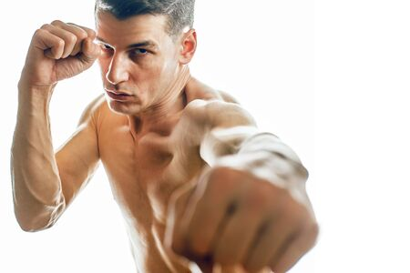 young handsome agressive man boxing isolared on white background, lifestyle sport people concept