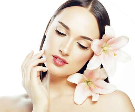 young attractive lady close up with hands on face isolated flower lily brunette spa makeup macro