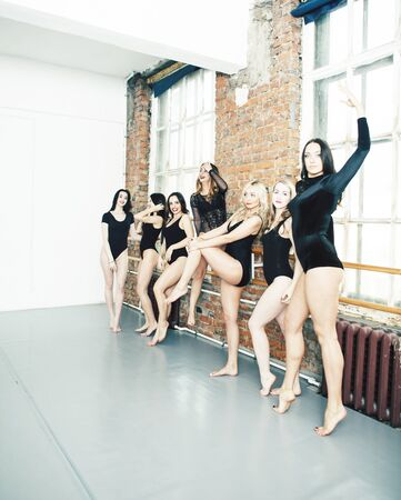 Many girls training in studio ballet, long woman legs sexy bracing, wearing sexual black bodysuit, lifestyle people concept Stock Photo - 126735715