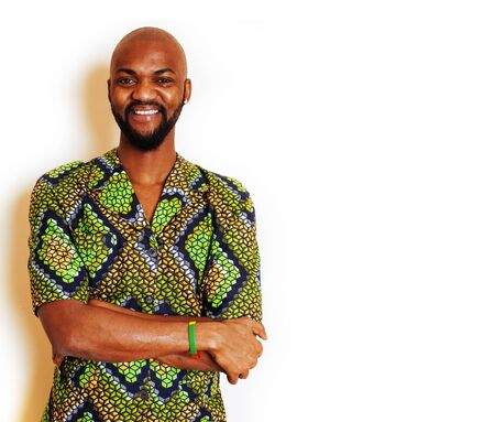 portrait of young handsome african man wearing bright green national costume smiling gesturing, entertainment stuff Stock Photo