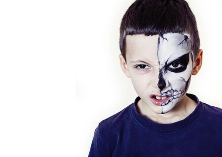little cute boy with facepaint like skeleton to celebrate halloween, lifestyle people concept, children on holiday close up Stock Photo