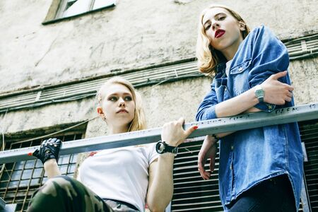 couple of teenage girls ouyside on streets chilling, lifestyle people concept Stock Photo