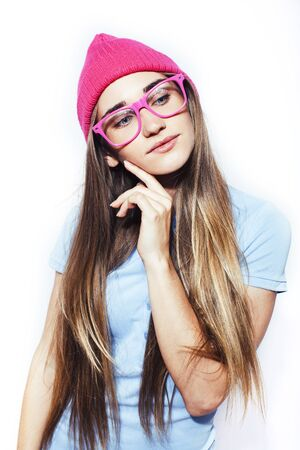 young pretty teenage modern hipster girl posing emotional happy isolated on white background, wearing pink hat and glasses, lifestyle people concept