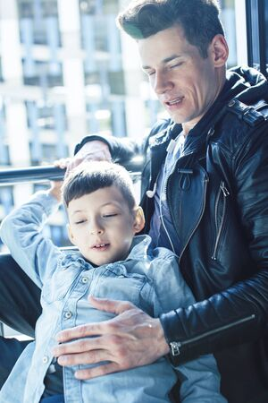 happy family together concept, father and son at window huggings, enjoying sunlight, lifestyle people at summer Imagens