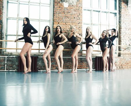 Many girls training in studio ballet, long woman legs sexy bracing, wearing sexual black bodysuit, lifestyle people concept Stock Photo - 129211110