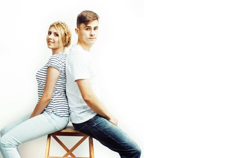 young pretty teenage couple, hipster guy with his girlfriend happy smiling and hugging isolated on white background, lifestyle people concept