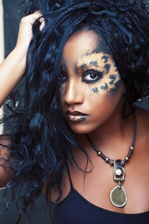 beauty afro girl with cat make up, creative leopard print closeup, fashion style halloween look Reklamní fotografie
