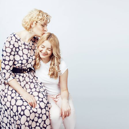 mother with teen daughter together posing happy smiling isolated on white background with copyspace, lifestyle people concept close up 스톡 콘텐츠 - 129463956