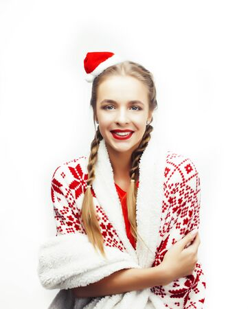 young pretty happy smiling woman on christmas in santas red hat posing isolated on white background, lifestyle people concept Stock Photo