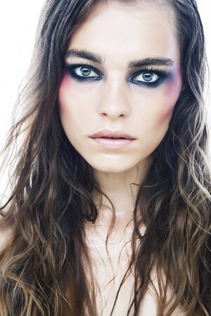 young pretty caucasian girl with fashion style makeup bright colorful eyes isolated on white background, new glamour trends closeup Stock Photo