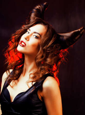 bright mysterious woman with horn hair, halloween celebration Stock Photo