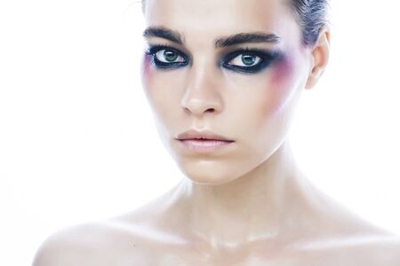 young pretty caucasian girl with fashion style makeup bright colorful eyes isolated on white background, new glamour trends closeup Фото со стока