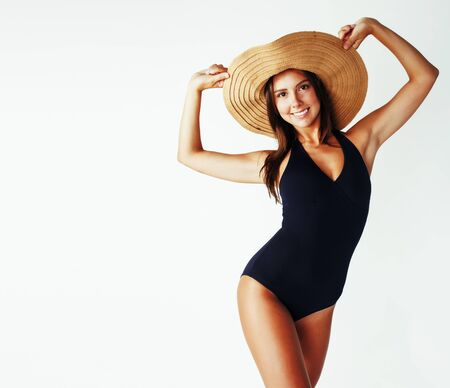 young pretty brunette woman wearing summer hat and swimsuit isolated on white background preparing to vacations, smiling emotional posing, lifestyle concept copyspace
