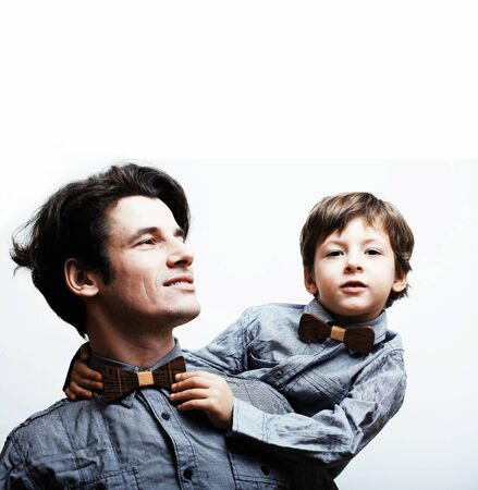 father with son in bowties on white background, casual look 版權商用圖片