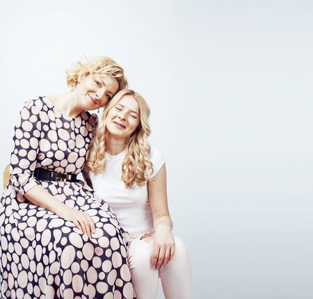 mother with teen daughter together posing happy smiling isolated on white background with copyspace, lifestyle people concept close up