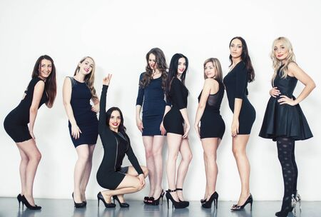 Many diverse women in line, wearing fancy little black dresses, party makeup, vice squad concept lifestyle Фото со стока