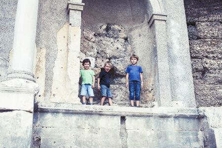 little boy exploring ancient architecture, lifestyle people on summer vacation close up