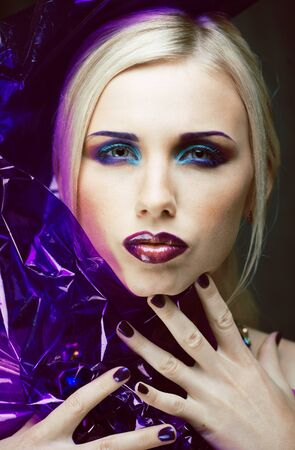 beauty woman with creative make up, many fingers on face close up