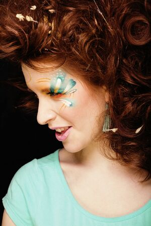 pretty funny girl with art make up, closeup floral print on face