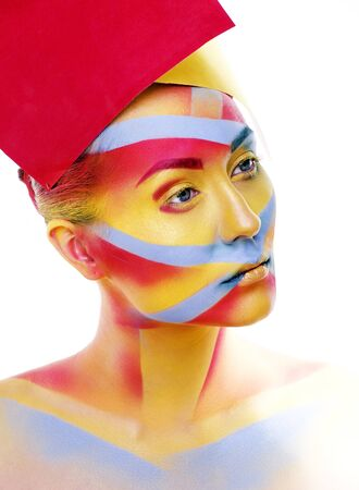 woman with creative geometry make up, red, yellow, blue closeup smiling colored, bright concept