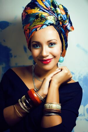 beauty bright african woman with creative make up, shawl on head like cubian closeup smiling Imagens - 132025459
