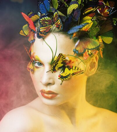 woman with summer creative make up like fairy butterfly closeup bright colored background Imagens
