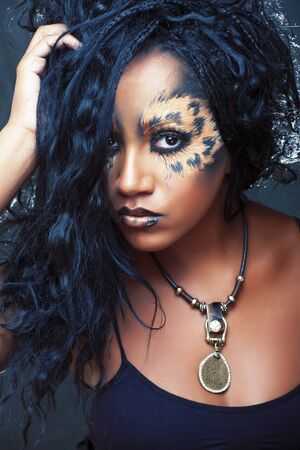 beauty afro girl with cat make up, creative leopard print closeup, fashion style halloween look Imagens