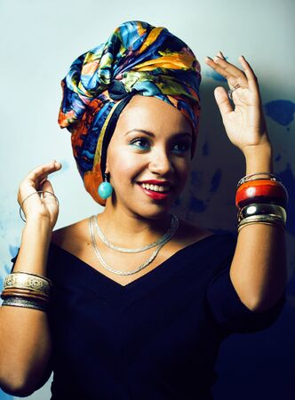 beauty bright african woman with creative make up, shawl on head like cubian closeup smiling Imagens - 132026727