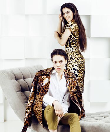 pretty stylish woman in fashion dress with leopard print together in luxury rich room interior, lifestyle people concept, modern brunette together close up Stockfoto