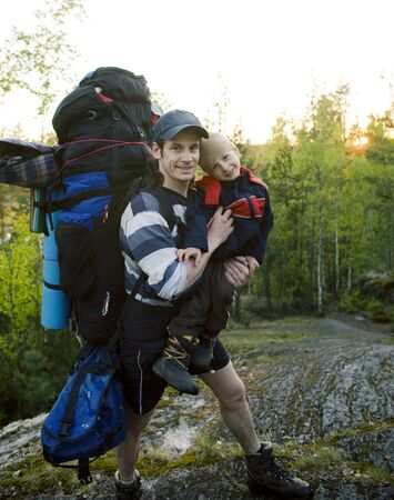 young happy father traveling with little son and huge backpack, lifestyle people concept