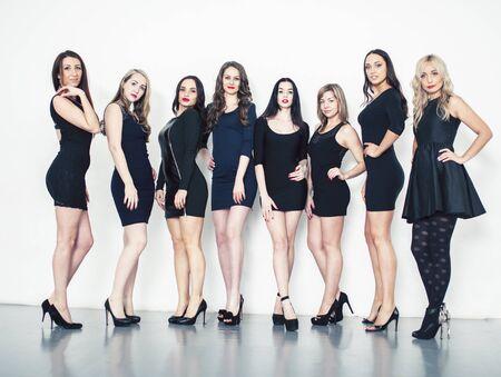 Many diverse women in line, wearing fancy little black dresses, party makeup, vice squad concept lifestyle Foto de archivo