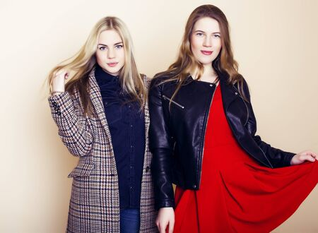 lifestyle and people concept: Fashion portrait of two stylish girls best friends, over white background. Happy time for fun