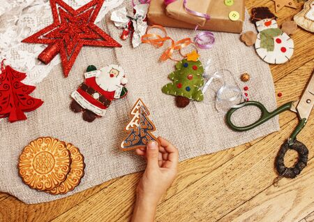Lot of stuff for handmade gifts, scissors, ribbon, paper with countryside pattern.