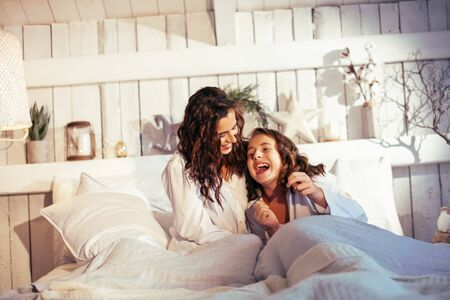 young pretty sisters at home early morning in hammock, lifestyle casual people concept