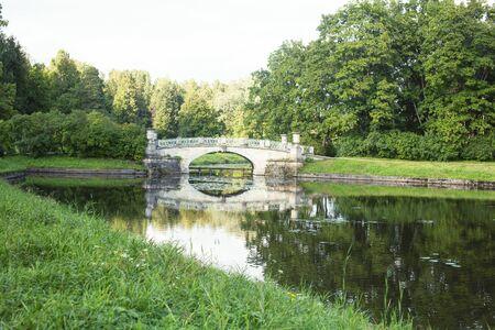 old vintage bridge on river in green park, landscape historical closeup Reklamní fotografie