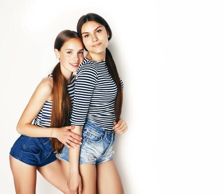 best friends teenage girls together having fun, posing emotional on white background, besties happy smiling, lifestyle people concept
