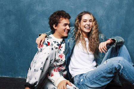young pretty boy and girl friends happy smiling together in interior, lifestyle people concept Stock Photo