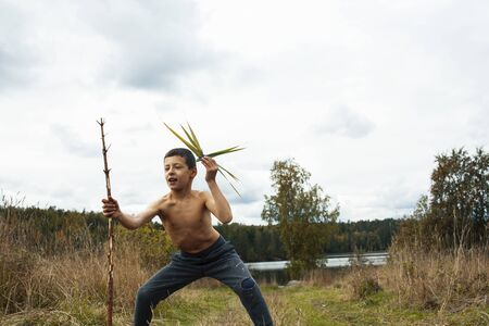 little cute boy playing outside like wild indian chief, lifestyle real people concept Stock fotó