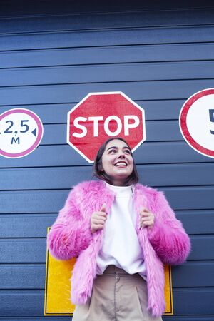 young cute girl teenager gesturing hanging around city parking and teasing with stop sign, lifestyle people concept 写真素材