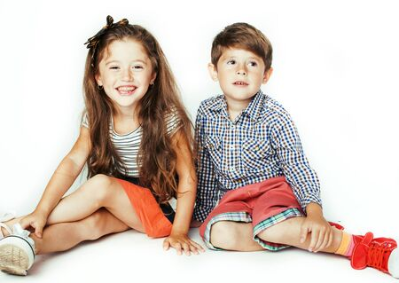 little cute boy and girl hugging playing on white background, happy smiling family, lifestyle people concept close up Banque d'images