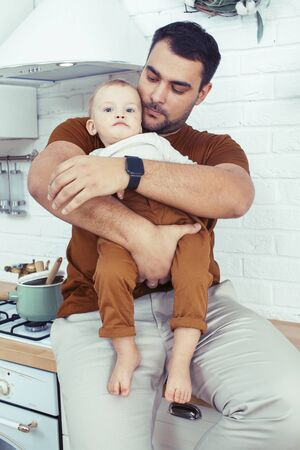 young real father with little cute son todler on kitchen in morning, lifestyle people concept 写真素材