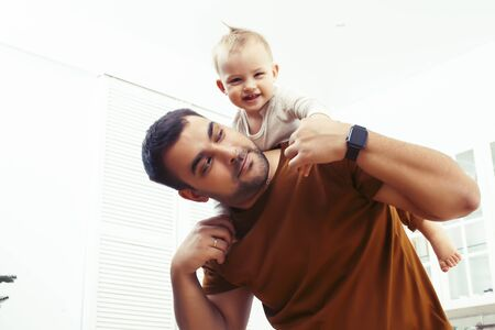 young real father with little cute son todler on kitchen in morning, lifestyle people concept Stock Photo - 136719569