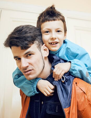 young handsome father with his son fooling around at home, lifestyle people concept