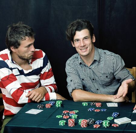 young people playing poker off-line tournament, friends party concept at home, lifestyle people concept Stock Photo