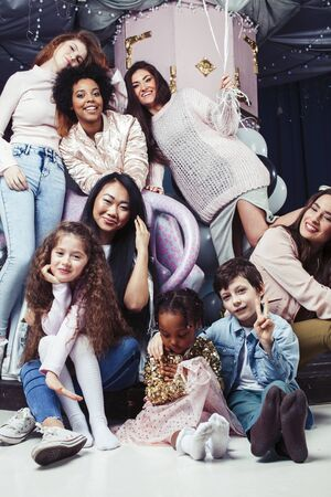 Lifestyle and people concept: young pretty diversity nations woman with different age children party together happy smiling, African-american, asian and caucasian