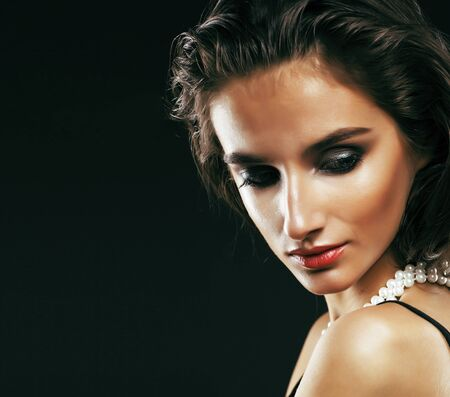 beauty rich woman with bright makeup wearing luxury jewellery on black background, fashion lady curly hairstyle