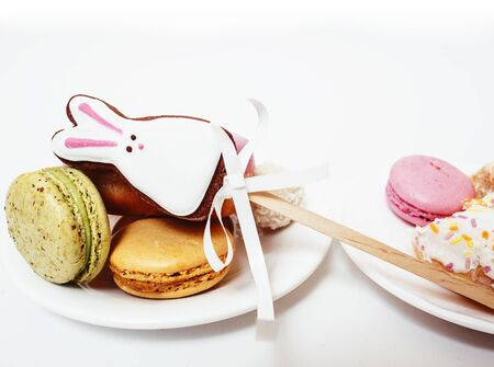 new real diet concept, question between red apple and donut with sweety candies macaroons isolated on white