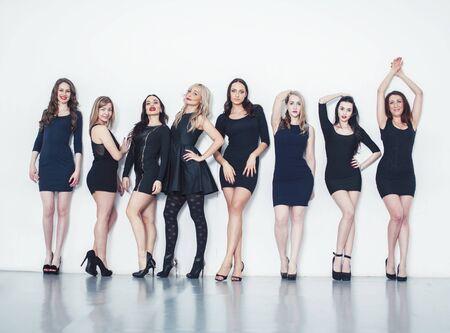 Many diverse women in line, wearing fancy little black dresses, party makeup, vice squad concept lifestyle Reklamní fotografie