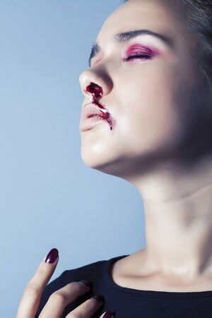 problem depressioned teenager with bleeding nose, real junky close up mainstream angry concept, lifestyle people Reklamní fotografie